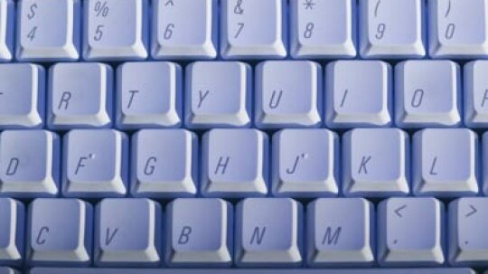 Why are the keys arranged the way they are on a QWERTY keyboard?