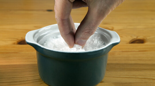Why do people throw salt over their shoulders?