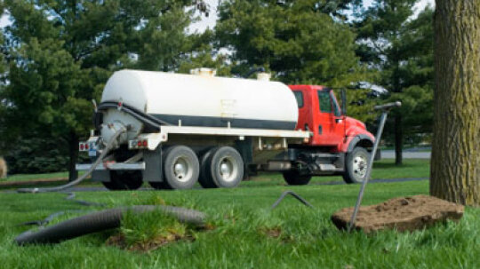 How often are septic tanks emptied, and where do the contents go?