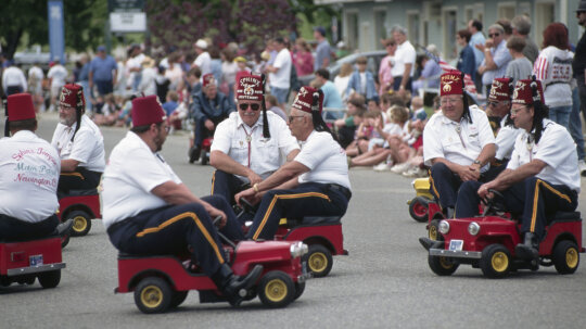 Why do Shriners drive those little cars?