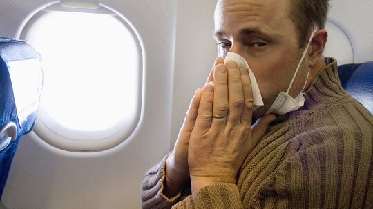 Why do sinus problems get worse during air travel?