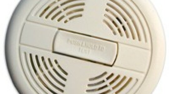How do smoke detectors intercommunicate?