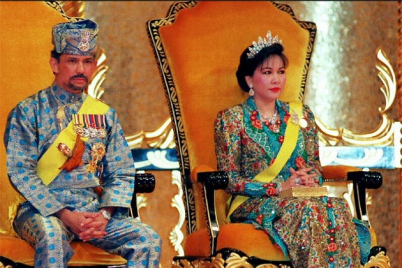 The Sultan of Brunei, Hassanal Bolkiah, and his second wife, Hajah Mariam, look slightly solemn during the sultan's 50th birthday celebrations in Bandar Seri Begawan. Francis Silvan/AFP/Getty Images