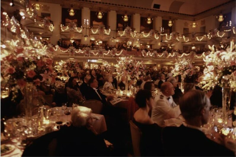 The guest lists for the 48th Annual International Debutante Ball (pictured here) and the Martin party were quite different, but the posh venue was the same: the Waldorf-Astoria Hotel. © Mark Peterson/Corbis