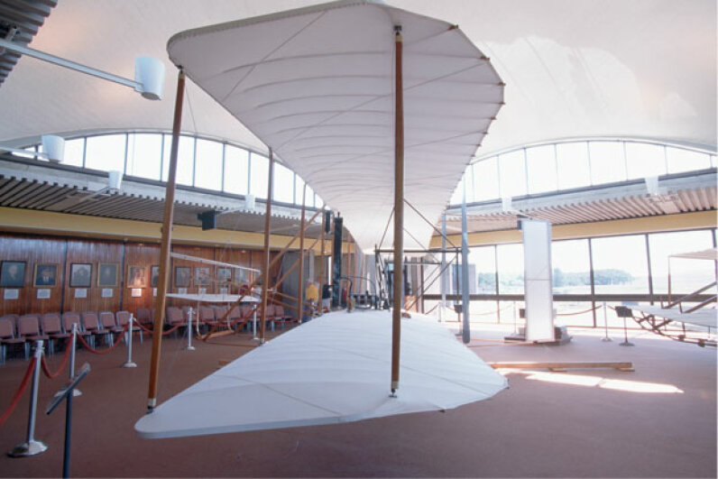 Full-size reproduction of the Wright brothers' 1902 glider at rest in the Wright Brothers National Memorial in Kitty Hawk, N.C. © Kevin Fleming/Corbis