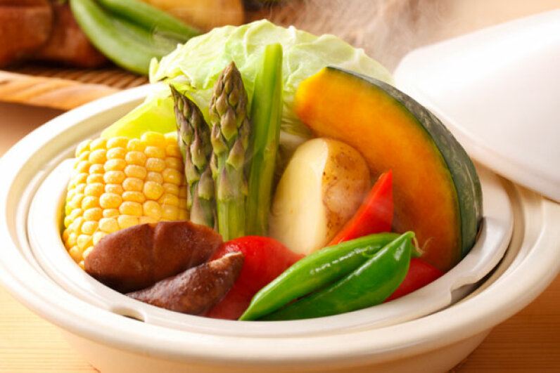 Steamed vegetables retain a bright color and crisp texture that can make an ordinary frozen dinner recipe much more appealing. MASAHIRO MORIGAKI/a.collectionRF/Getty Images
