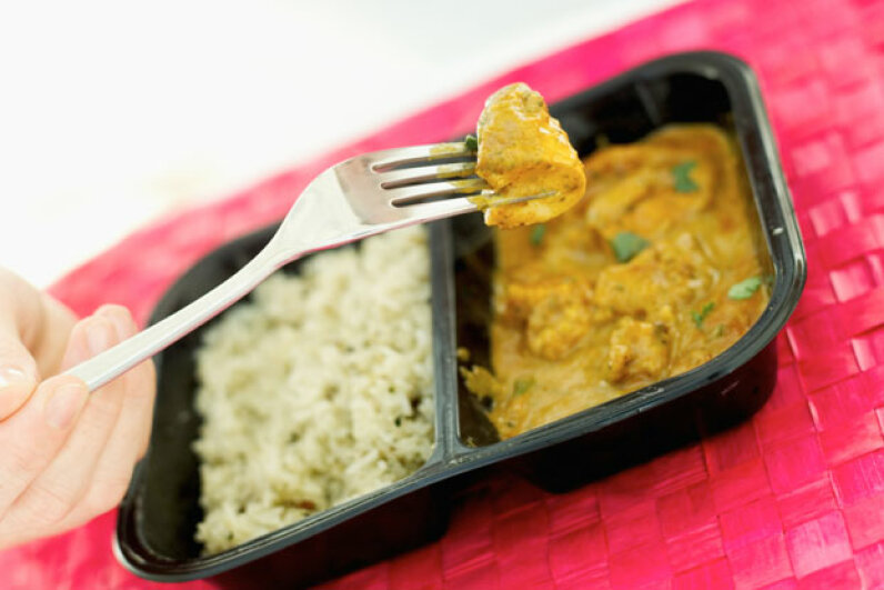 """Did the makers of the original turkey """"TV Dinner"""" ever imagine they were establishing precedent for a future of instant, fragrant curry dishes from the microwave? Stockbyte/Getty Images"""