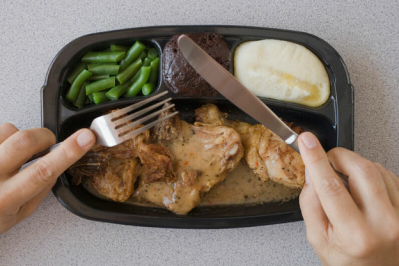 Microwavable plastic trays made frozen food even easier -- and cut cooking times down to less than a fifth of what they once were. Tetra Images/Getty Images