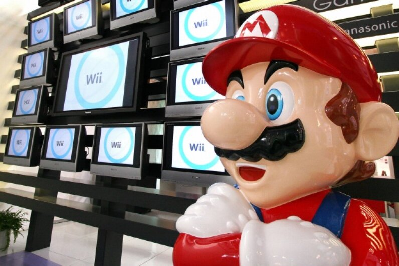 Super Mario stands at a showroom in Tokyo on Jan. 25, 2007, years before Andrew Gardikis would blow through his record-setting game in under five minutes. Yoshikazu Tsuno/AFP/Getty Images