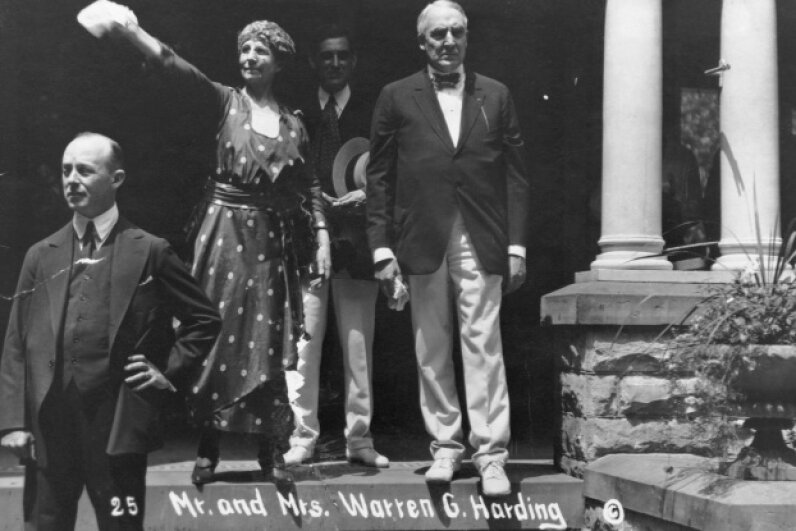 It was U.S. President Harding who would coin the enduring phrase Founding Fathers to describe the people who helped shape the U.S. during the Revolutionary era. He's pictured here with his wife Florence on the front porch of the Harding house in Marion, Ohio. © Corbis
