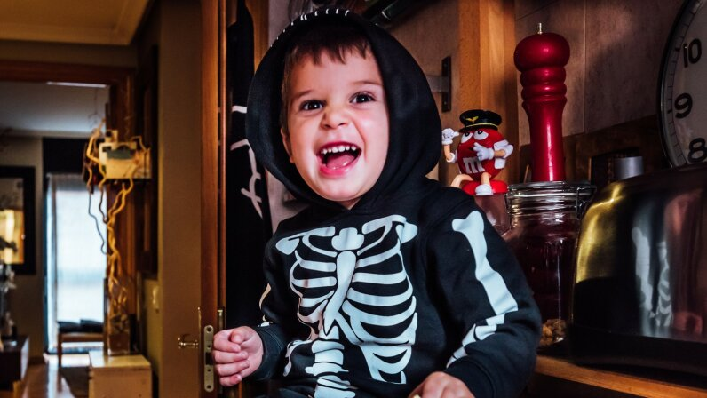 kid in skeleton costume