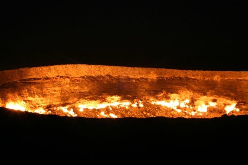 The Darvaza gas crater burns through the night. iStock/Thinkstock