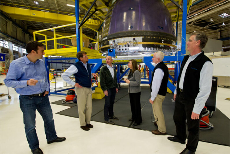 NASA visits with Blue Origin founder Jeff Bezos, third from left, in December 2011. You can see Blue Origin's crew capsule in the background. Photo courtesy NASA/Bill Ingalls