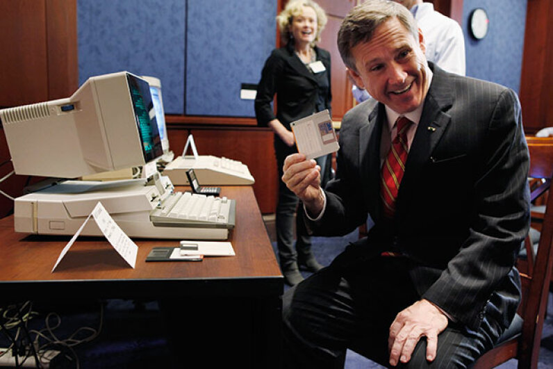 U.S. Senator Mark Kirk pulls a 3.5-inch floppy disc (remember those?) from a IBM PC Convertable. The historic machine was on display as part of the 25th anniversary of the Electronic Communications Privacy Act in 2011. Getty Images