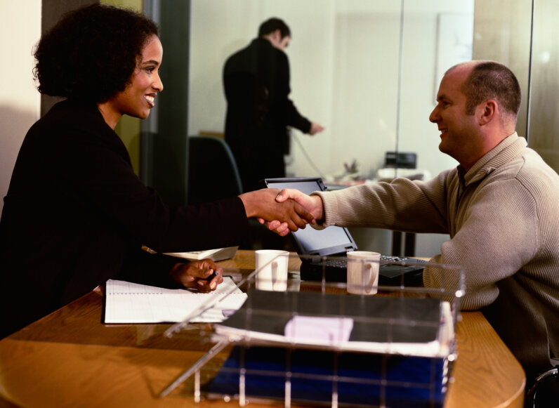 businessman and woman, handshake