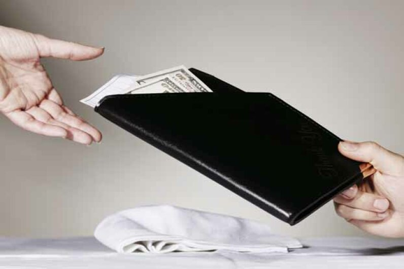 A generous tip can really make a waiter's day. Brand New Images/Digital Vision/Getty Images