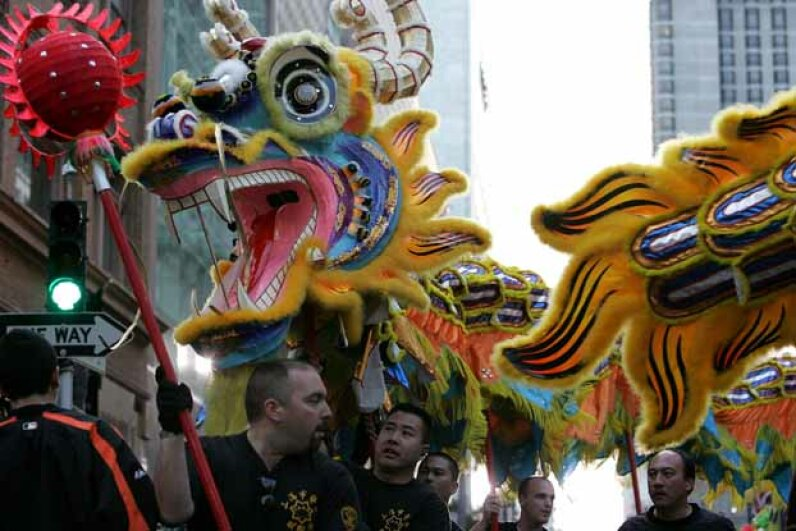 Members of a dragon team perform during the San Francisco Chinese New Year Festival.  This year, broaden your horizons by checking out a new cultural event. Justin Sullivan/Getty Images