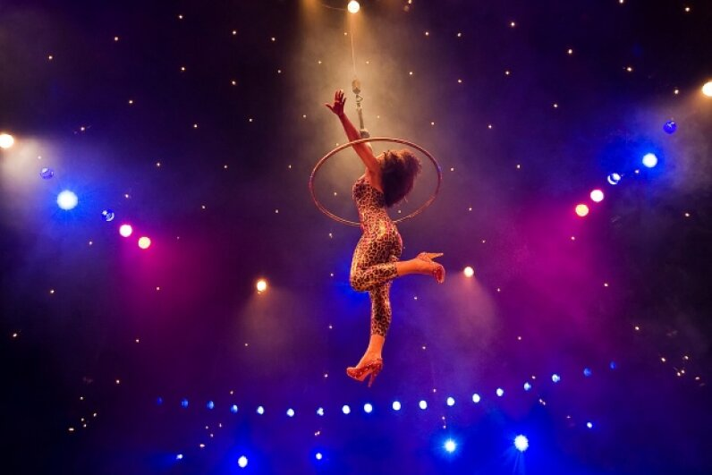 Hula hoop artist 'Marawa' performs during a photocall to promote the 'La Clique' Cabaret in London.