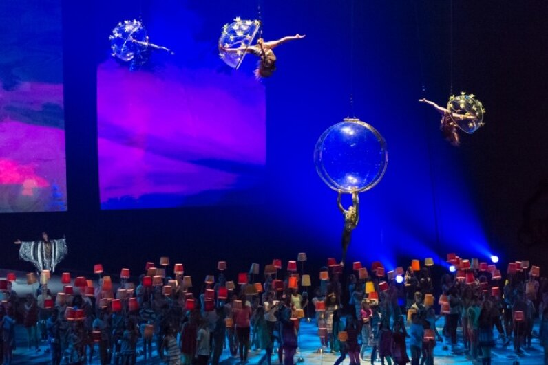 Cirque du soleil performs in the air and on the stage during the opening ceremony of the Toronto 2015 PanAm games.