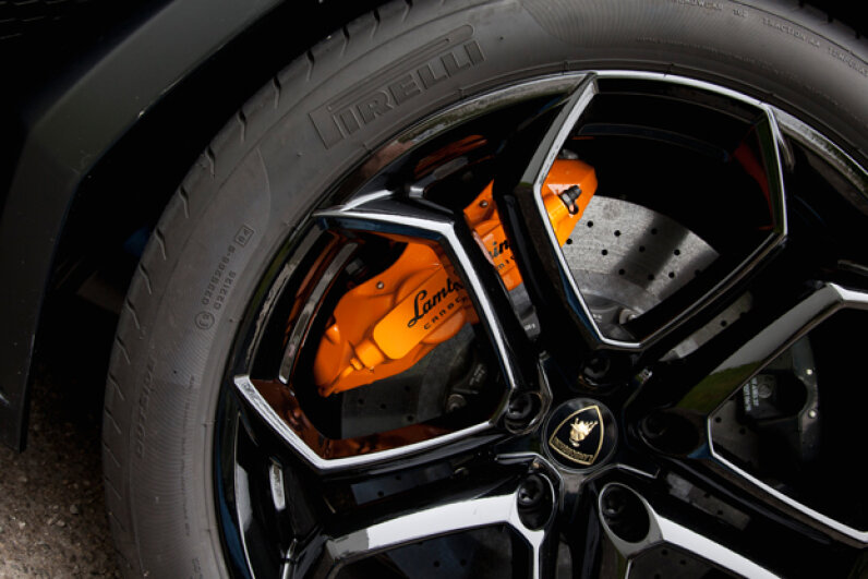 In some cars, sensors will tell you when the brake pads are getting thin and losing their stopping power. Transtock/Corbis