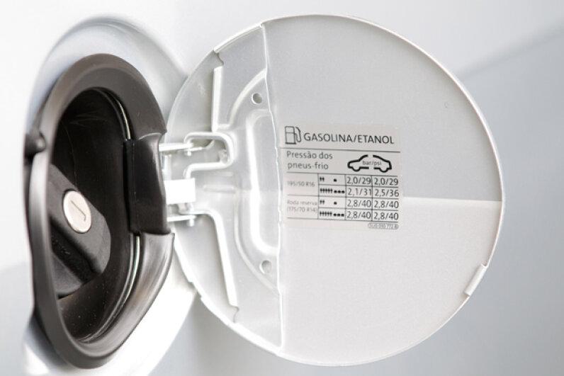 If your check engine light illuminates, try tightening the gas cap. Friso Gentsch/dpa/Corbis