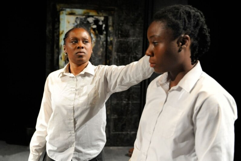 "Actresses Natasha Gordon and Demi Oyediran as the Gibbons twins in a play exploring their unusual story titled ""Speechless"" at the Edinburgh Festival Fringe in 2010. © Robbie Jack/Corbis"