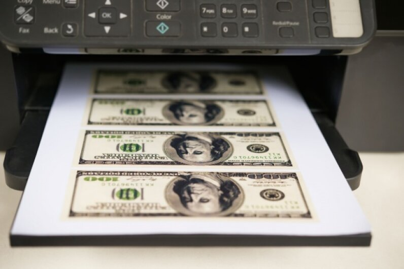 Printing at home is convenient, but the costs add up in a hurry. Don't turn to a life of counterfeiting to fill the gap, though.  © Freer Law/iStockphoto