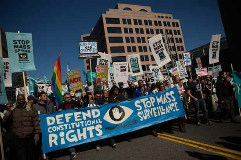 Protesters march through downtown Washington D.C. during the Stop Watching Us Rally, protesting surveillance by the NSA on Oct. 26, 2013, Allison Shelley/Getty Images