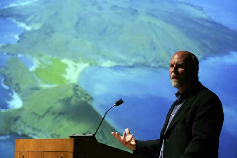 "J. Craig Venter speaks after a screening of ""Cracking the Ocean Code,"" at the American Museum of Natural History in 2006. Venter and his team have discovered at least 5 million new genes and 7,000 new microbial species in waters all over the planet. Michael Nagle/Getty Images"