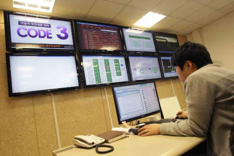 An IT security researcher looks for computer viruses in Seoul, South Korea in 2013. A cyberattack on the networks that ran three banks, two broadcasters and an ISP was traced to an IP address in China, but experts think the attacks were from North Korea. Chung Sung-Jun/Getty Images
