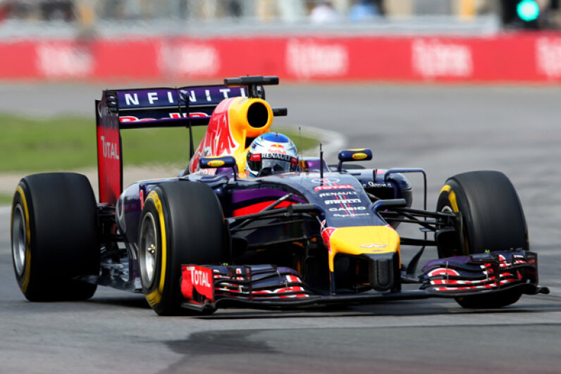Sebastian Vettel drives during the Canadian Formula One Grand Prix at Circuit Gilles Villeneuve in Montreal, Canada -- there's a lucky coin in there somewhere. (Photo by Mark Thompson/Getty Images)