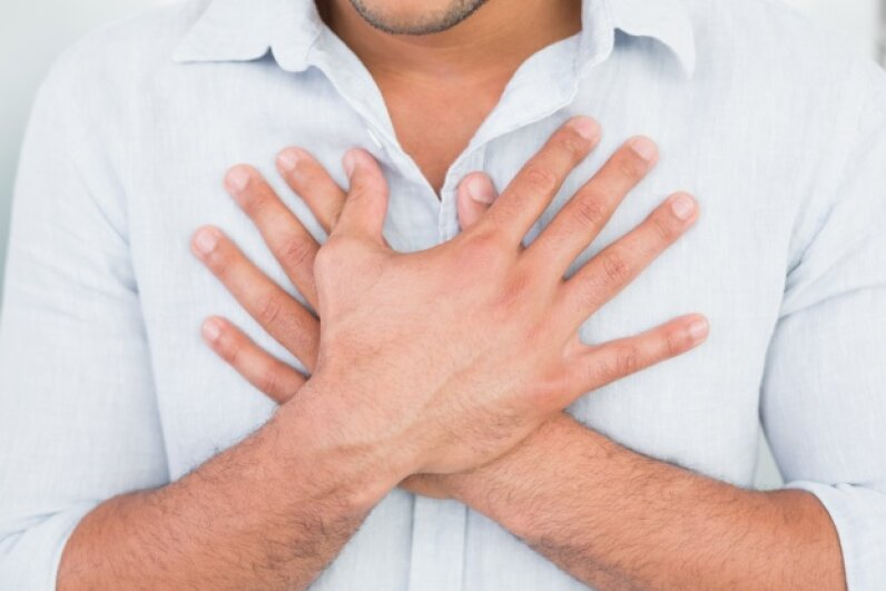 Chest pains are certainly one well-known sign of an impending heart attack, but did you know that excessive sweating may be another? Wavebreakmedia Ltd./Lightwave Media/Thinkstock
