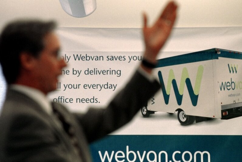 An auctioneer taking bids during the sale of Webvan's assets at its former headquarters in Foster City, Calif. on Oct. 31, 2001. ©Dan Krauss/Getty Images