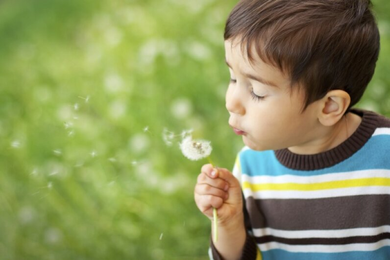 All fun and games until your lawn is sprouting dandelions like mad. palinchakjr/iStock/Thinkstock