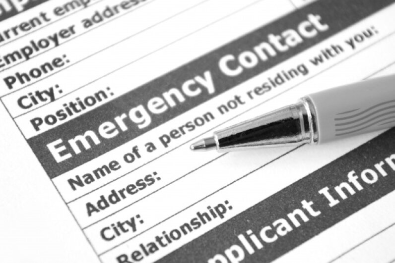 You might not be able to fill out emergency contact paperwork when you're admitted to the ER, so include that information on your phone's contact list or on a contact card in your wallet. ©Igor Dimovski/iStock/Thinkstock