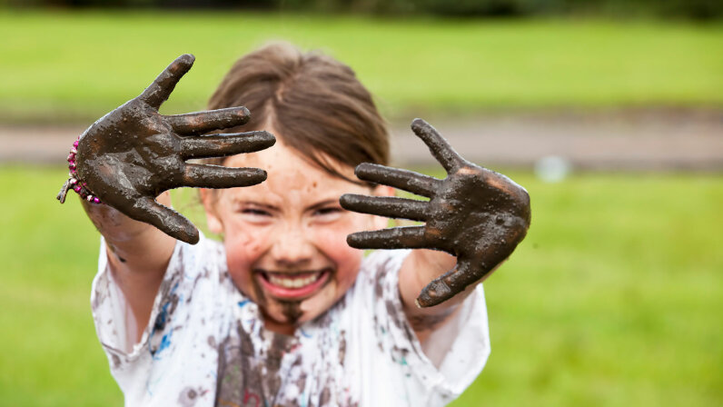 girl playing in mud