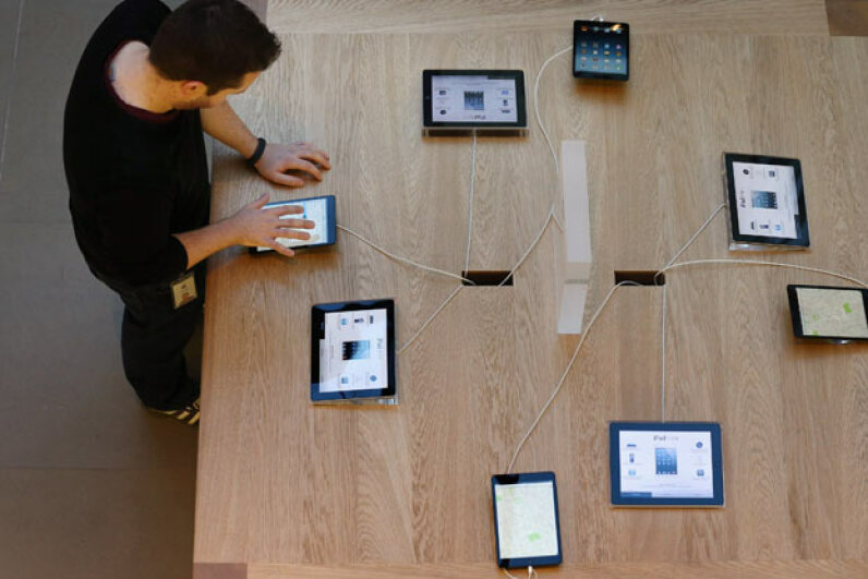 An Apple employee uses the iPad mini at the tablet's launch in the UK in November 2012. Oli Scarff/Getty Images News