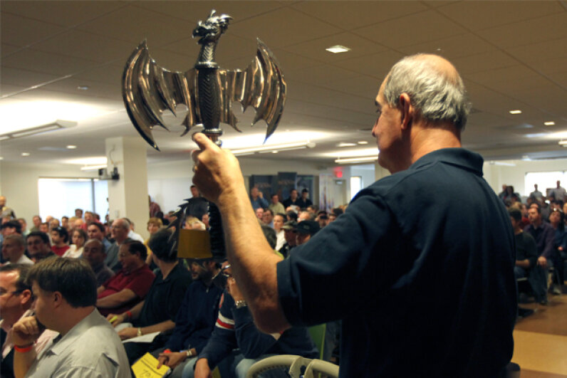 Joe McIntyre holds up a hatchet as the contents of Curt Schilling's bankrupt video game company 38 Studios are auctioned off in 2010. Bill Greene/The Boston Globe/Getty Images