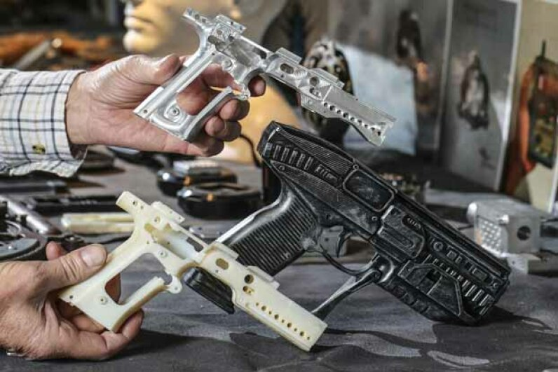 Walter Klassen holds a fantasy gun that actually fires blanks, which he created on his 3-D printer. © David Cooper/ZUMA Press/Corbis