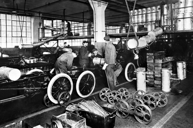 At the Highland Park Plant in 1913, Henry Ford introduced the first moving assembly line for cars. Within 18 months it took only 1.5 man-hours to build a Model T. (Courtesy of the Ford Motor Company)
