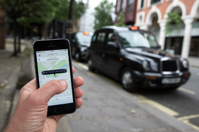 A smartphone displays the 'Uber' mobile application which allows users to hail private-hire cars from any location in London, England. (Oli Scarff/Getty Images)