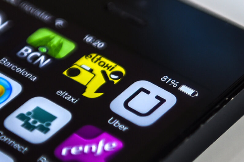 Logos of 'Uber,' a Barcelona taxi service and Barcelona City guide apps are seen on a smartphone display in Barcelona, Spain. (David Ramos/Getty Images)