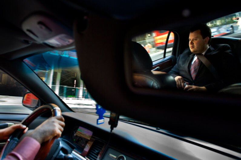 Brendan Kownacki rides in the UBER Car that he beckoned via a smartphone app. He pays a little more for an Uber ride than he would for a cab, but he says it's worth it. (Linda Davidson/The Washington Post via Getty Images)