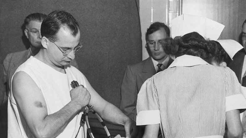 Dr. James G. Shanklin, a hospital psychiatrist, administers electric shock and anesthesia to a patient in 1949. The DSM was originally developed to catalog psychiatric disorders at a time when mentally ill people received poor or no treatment. Bettman/Getty Images