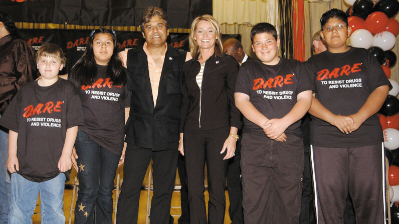 Actor Erik Estrada and former gymnast Nadia Comaneci (C) pose with D.A.R.E. students during a rally for the proclamation of National D.A.R.E. (Drug Abuse Resistance Education) Day April 11, 2002 in North Hollywood, California.  Robert Mora/Getty Images