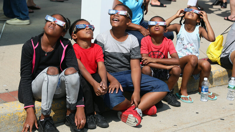 Don't trash your eclipse glasses. Recycle, reuse or donate them. Photo by Bruce Bennett/Getty Images