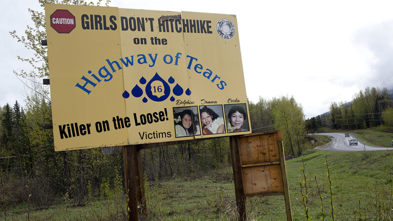 A road sign on Canada's Route 16, which connects Prince George with Prince Rupert, warns women and girls not to hitchhike out of fear they could be kidnapped or murdered. Andrew Lichtenstein/Corbis via Getty Images