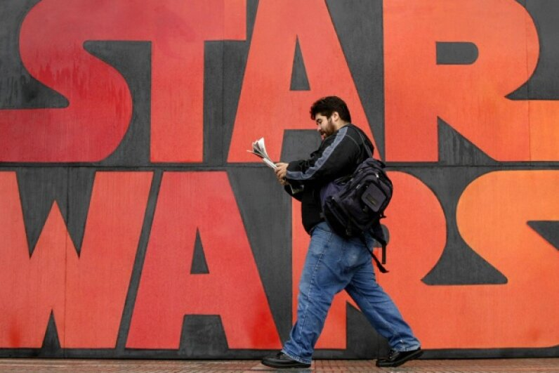 A man walks past a poster promoting the 'Star Wars' final episode in Santiago, Chile, on May 18, 2005. It's pretty much a heavyweight across all film genres. Martin Bernetti/AFP/Getty Images