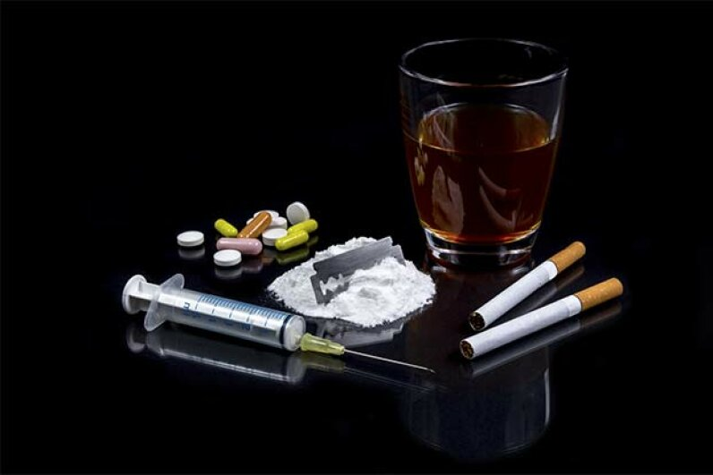 Even though some street drugs are more lethal than alcohol, alcohol addiction is far more widespread than drug addiction -- mainly because alcohol is legal. kunertus/iStock/Thinkstock