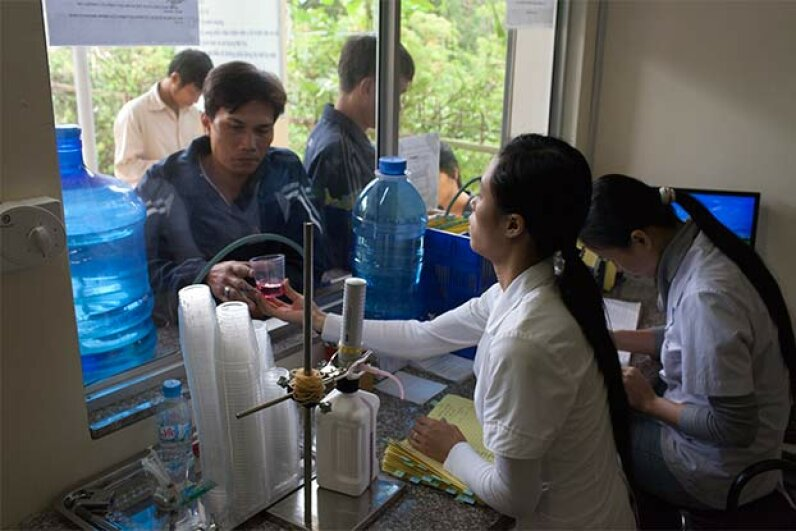 A nurse at the An Duong District Health Center of Hai Phong city, Vietnam prepares methadone for drug addicts. Chau Doan/LightRocket via Getty Images